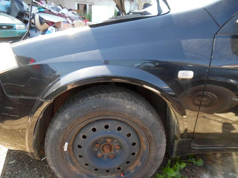 Nissan Primera P12 Kombi Bj:2003 Kotflügel Vorne Links Farbe : schwarz
